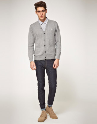 Cardigans tend to act like ersatz sport coats with the knit aspect anchors it sufficiently in casual wear. Also note the tan desert boot and Levi's combo.